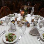 Dinner table setting for wedding in white