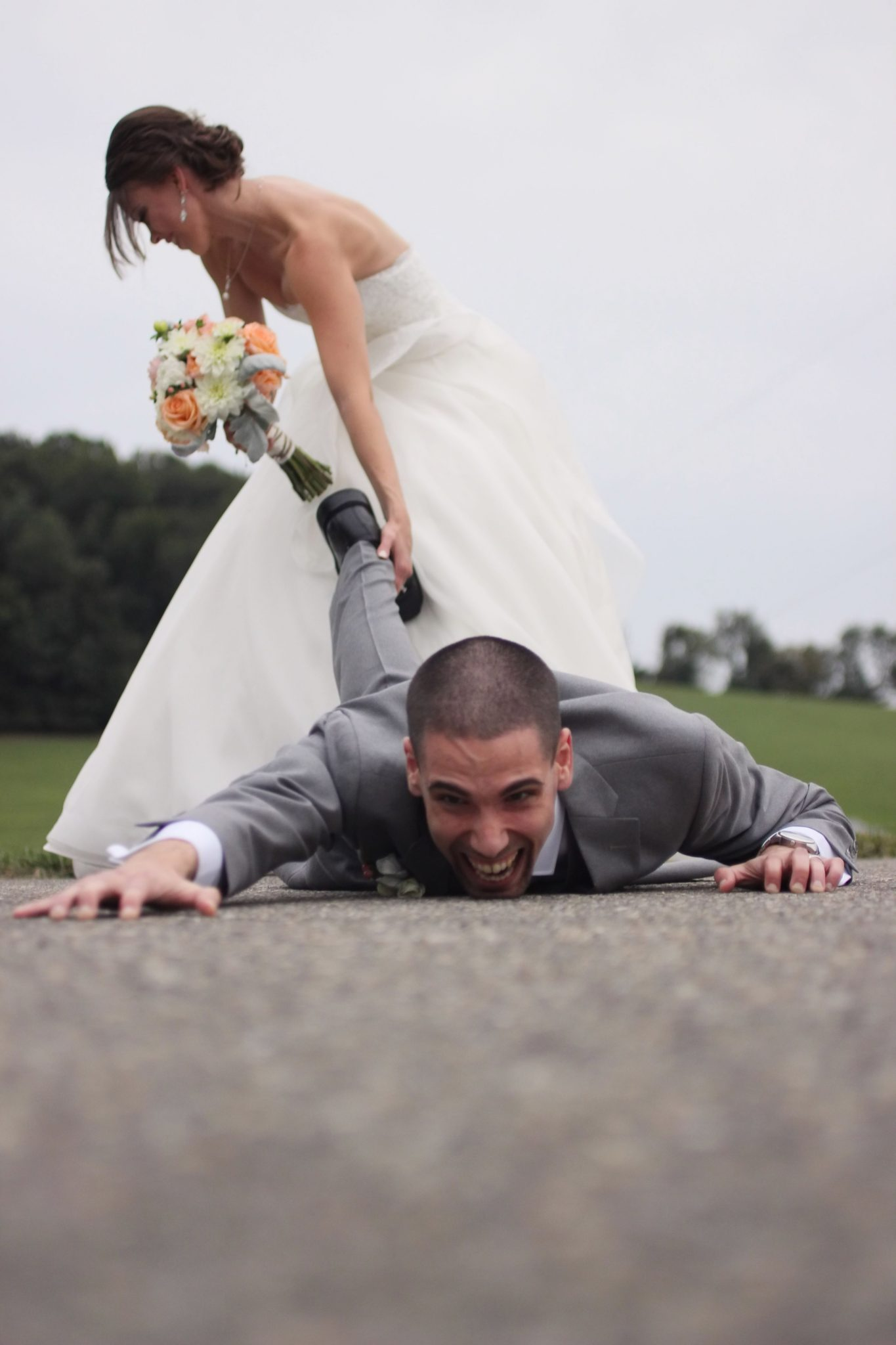 dragging the groom to the alter