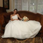 Bride on sofa in bride's room at Morningside Inn country wedding venue in Frederick Maryland