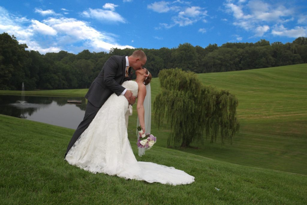 Bride and Groom kiss at wedding reception venue in Frederick Maryland