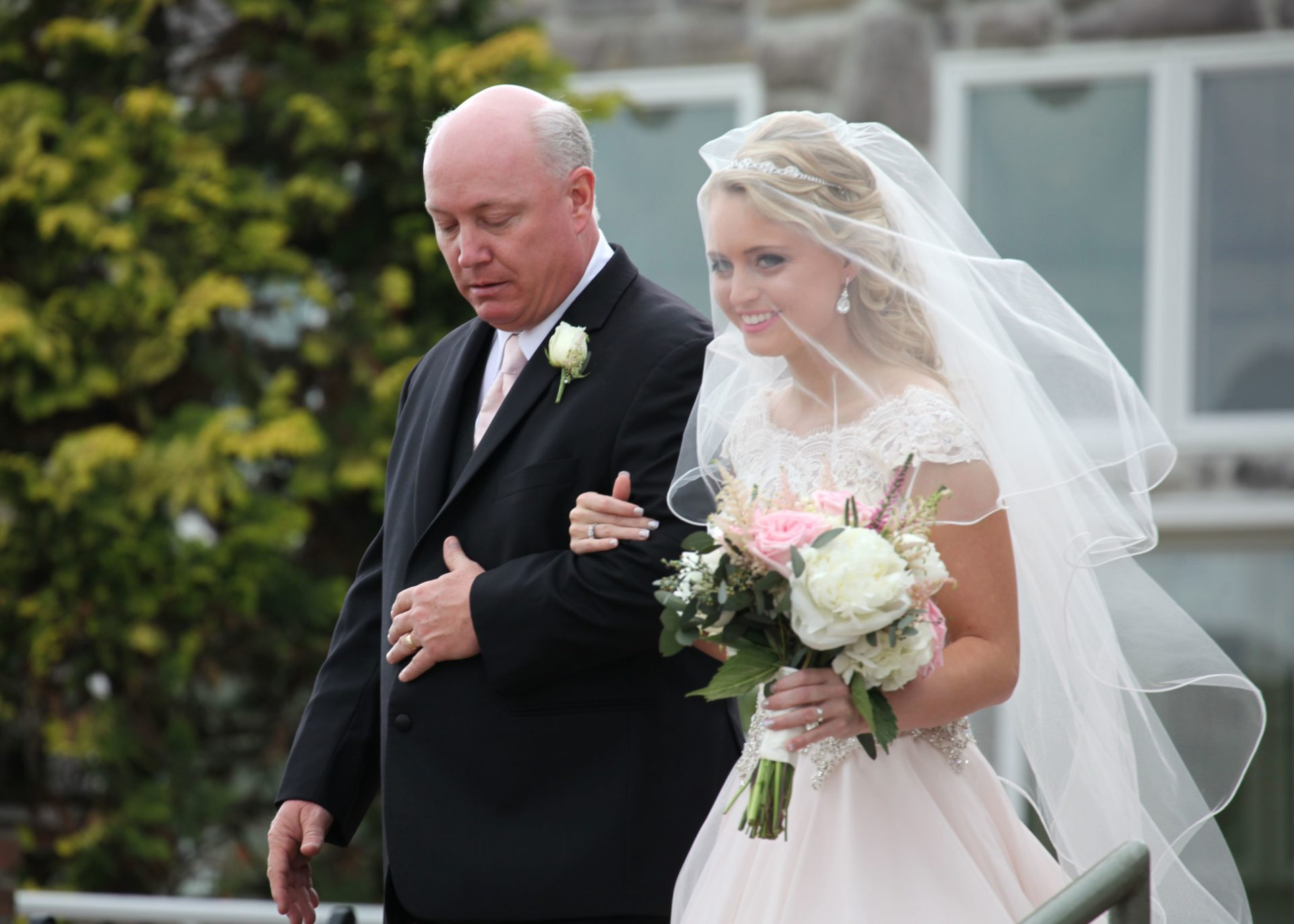 Father of the bride walks bride down aisle at outdoor wedding ceremony in Frederick at Morningside Inn