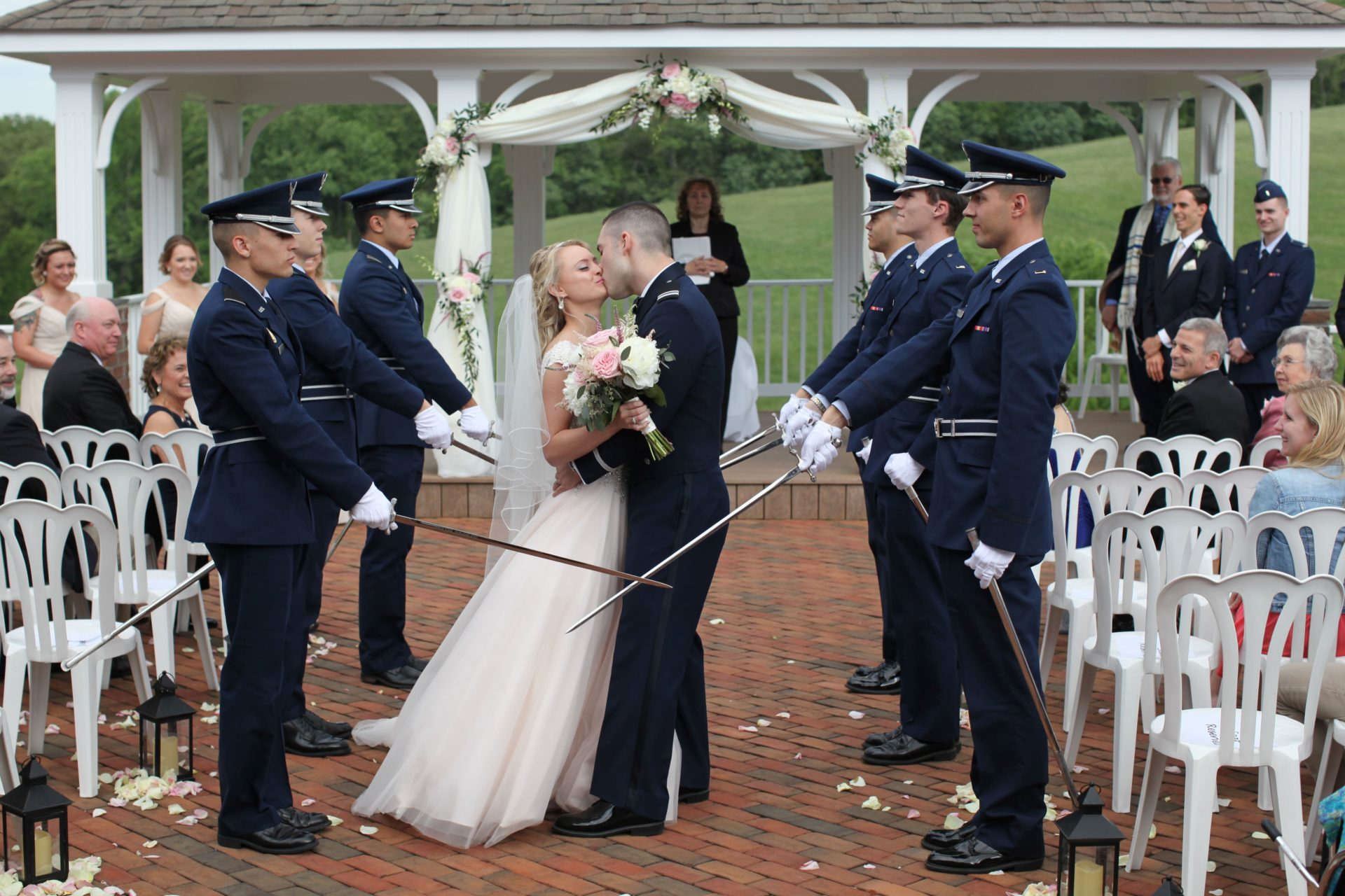 Bride and groom kiss after during military wedding at Morningside Inn