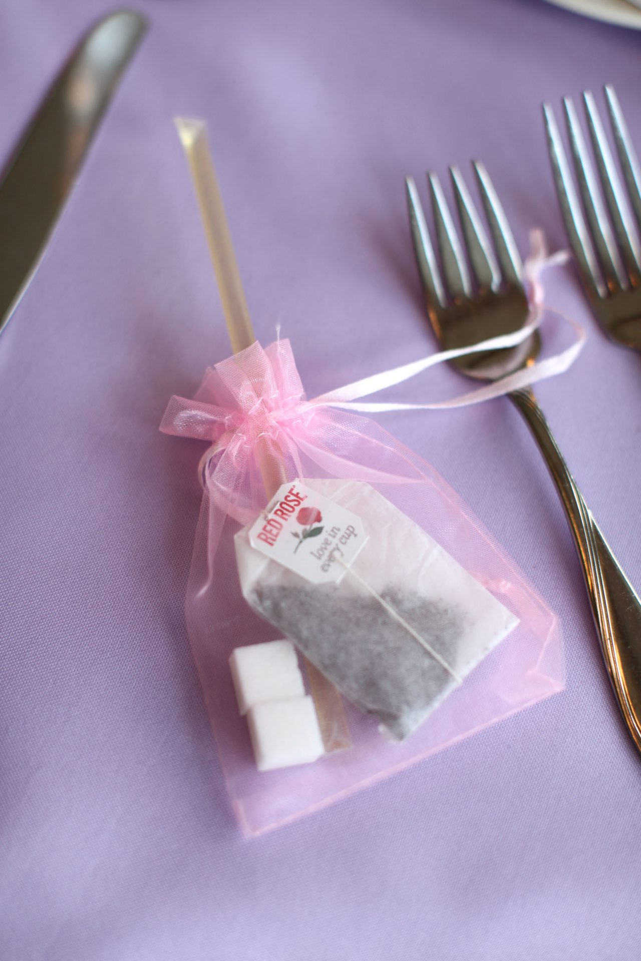 tea party theme wedding wedding favor of tea bag, sugar cubes, and honey stick