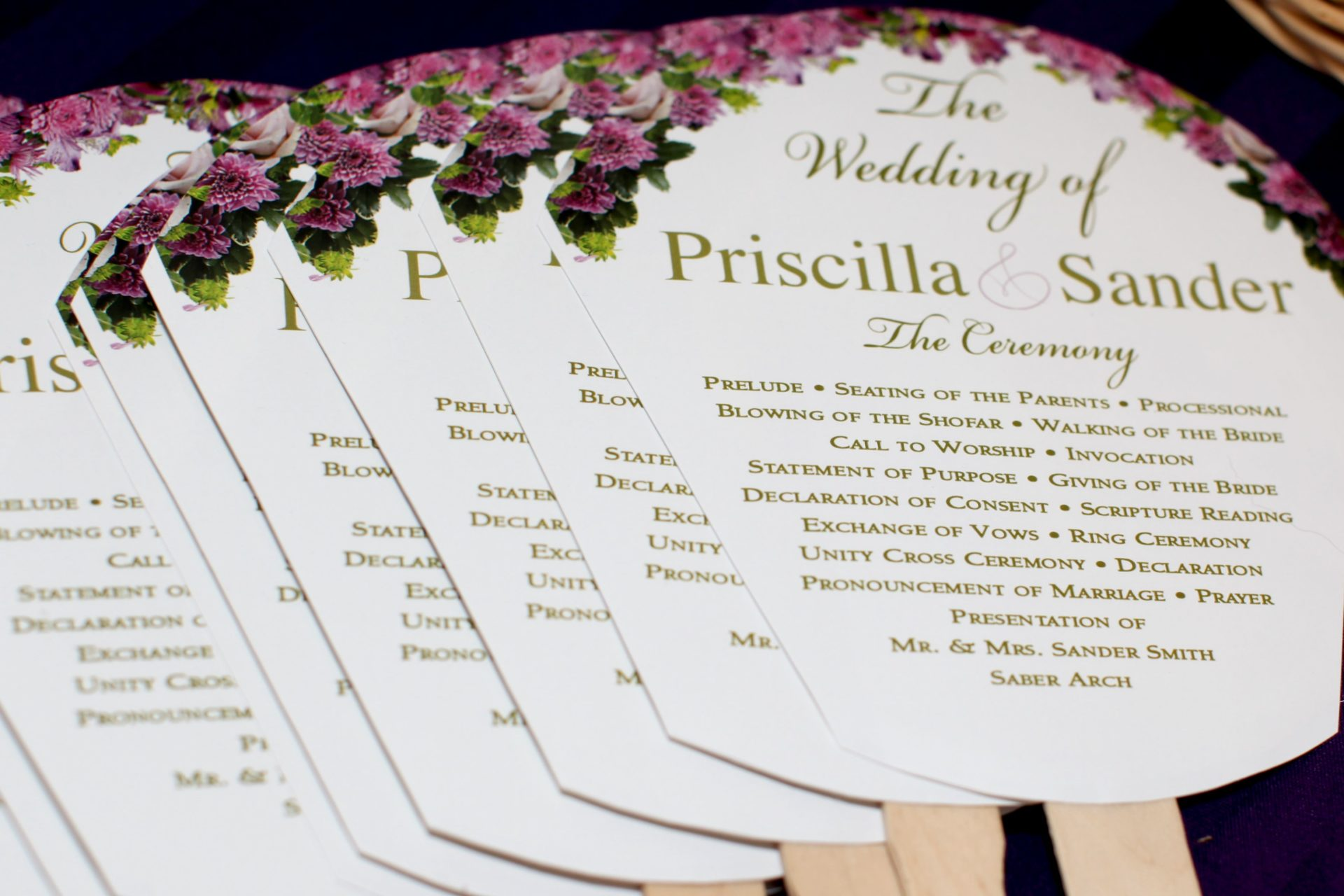 Wedding programs and fans for outdoor wedding during tea party theme wedding