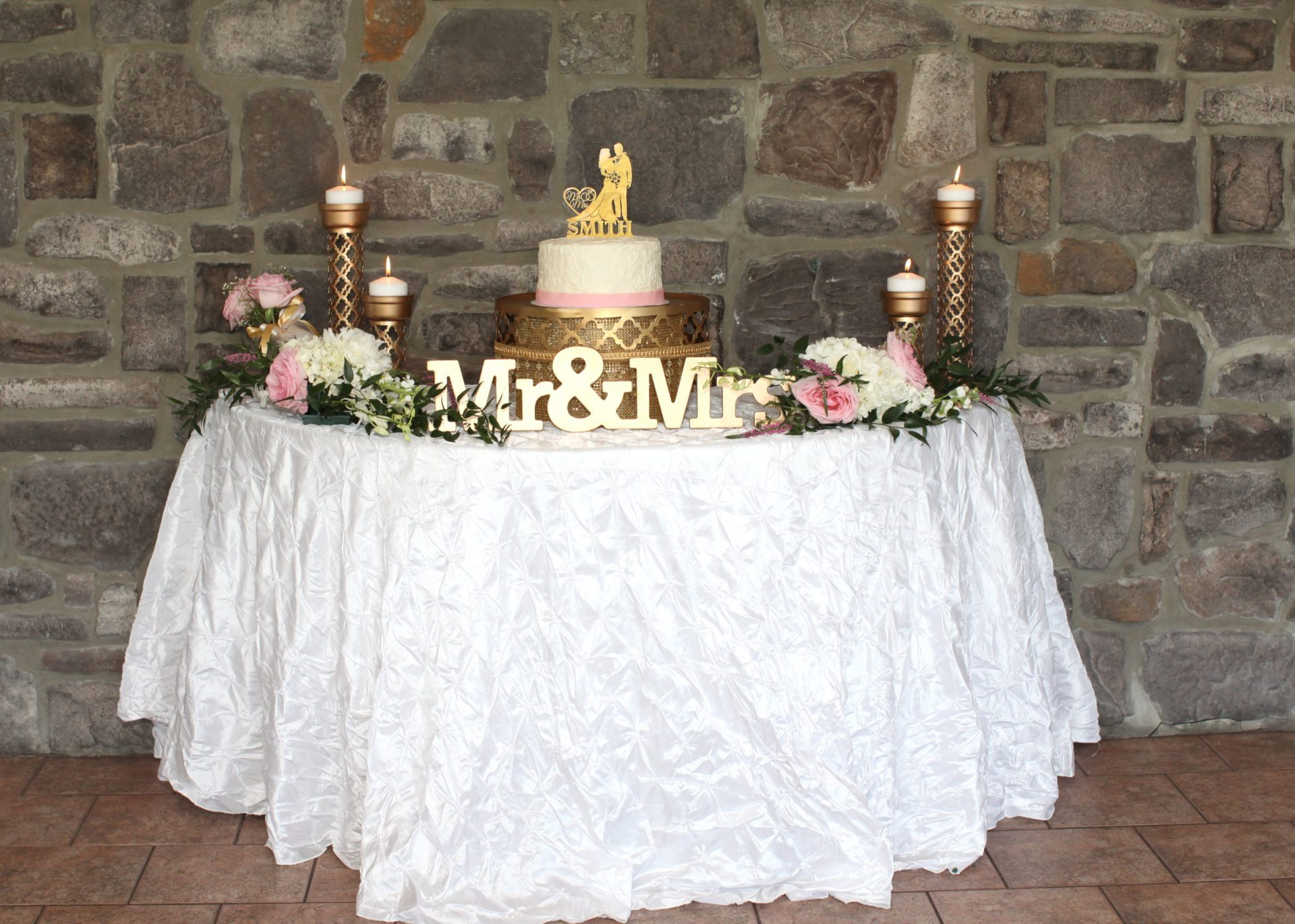 Cake table for tea party themed wedding