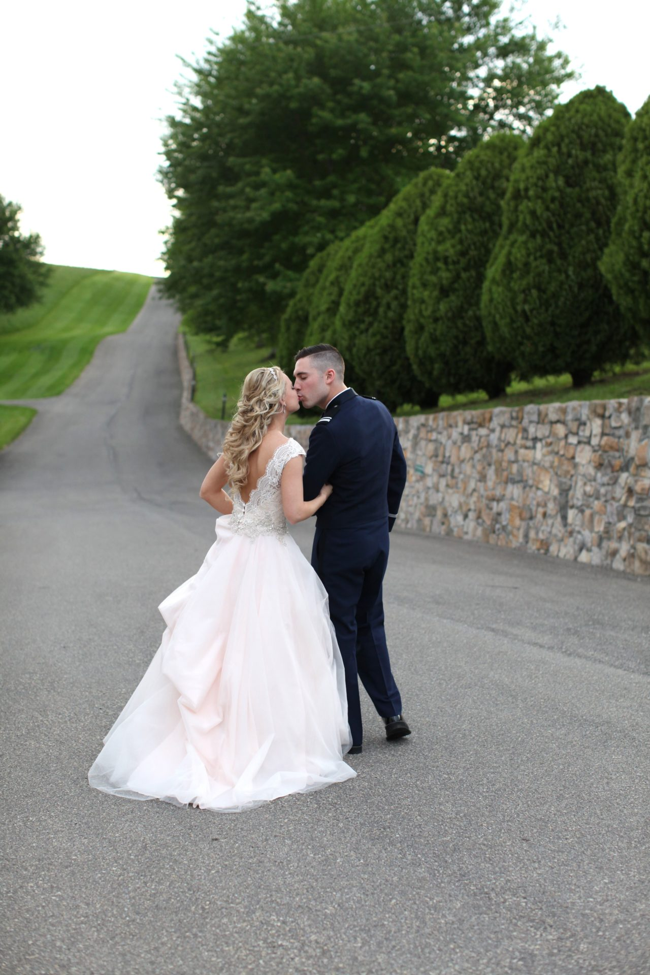 Bride and groom kiss in driveway of Morningside Inn wedding venue in Maryland
