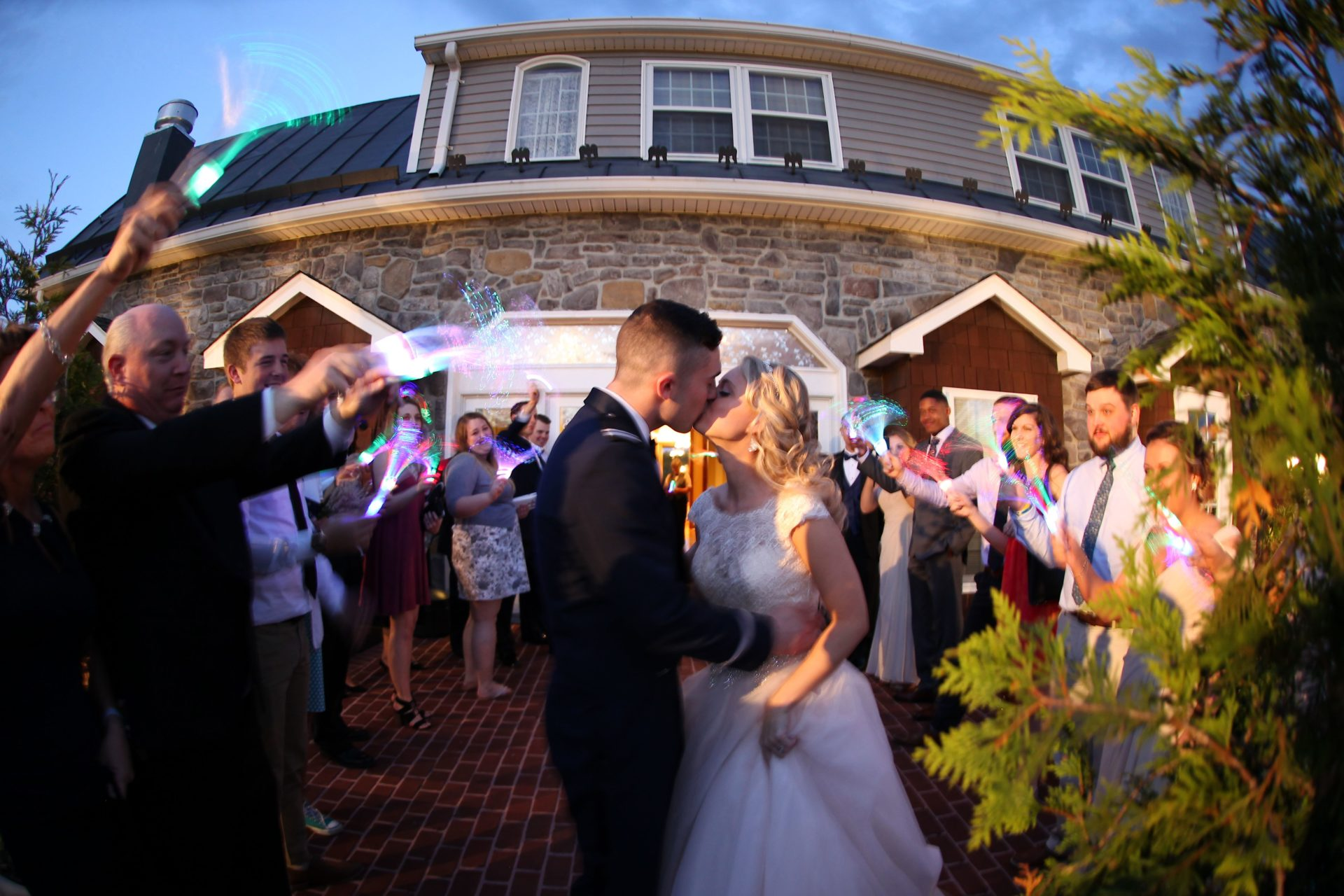 Kiss in front of Morningside Inn at send off after tea party themed wedding