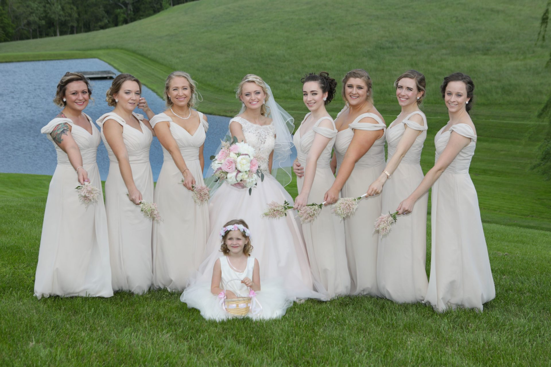 Brides maids by pond before tea party theme wedding at Morningside Inn