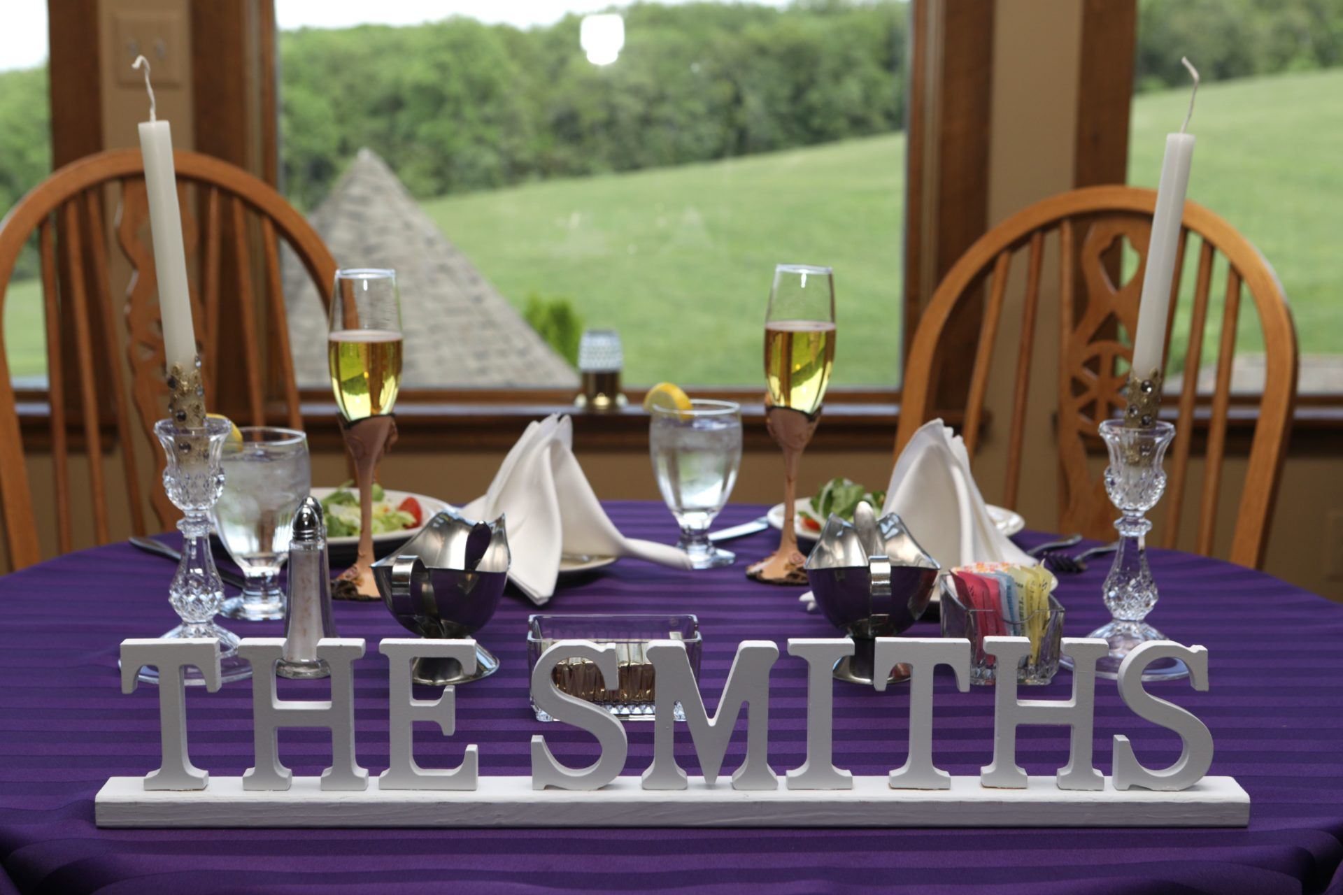 Head table decoration of couples new last name during tea party theme wedding in Frederick