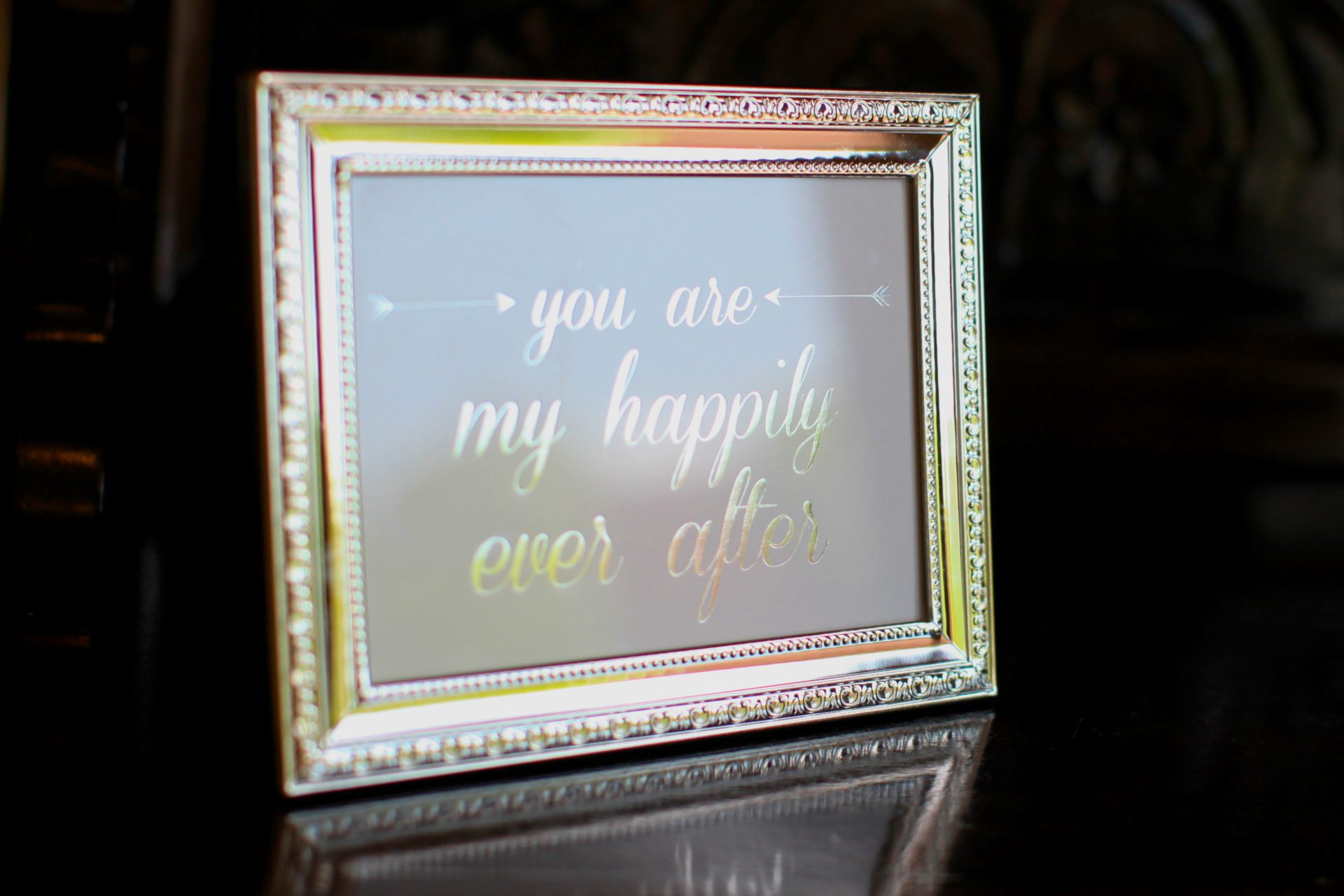 Frames decorated the wedding with love quotes such as You are my happily ever after