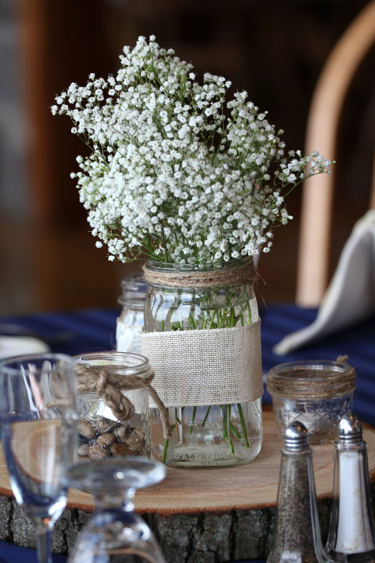 Rustic wedding centerpiece with jar and baby's breath flowers