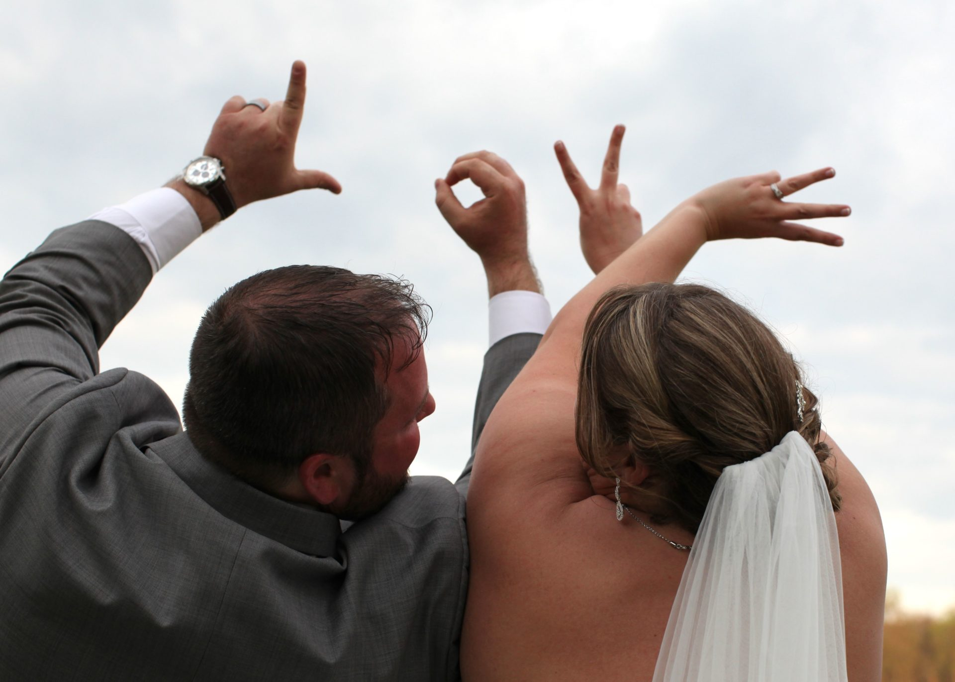 Bride and groom LOVE with hands